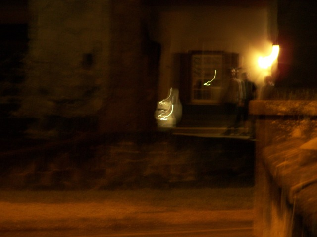 The ghost Elizabeth waving.